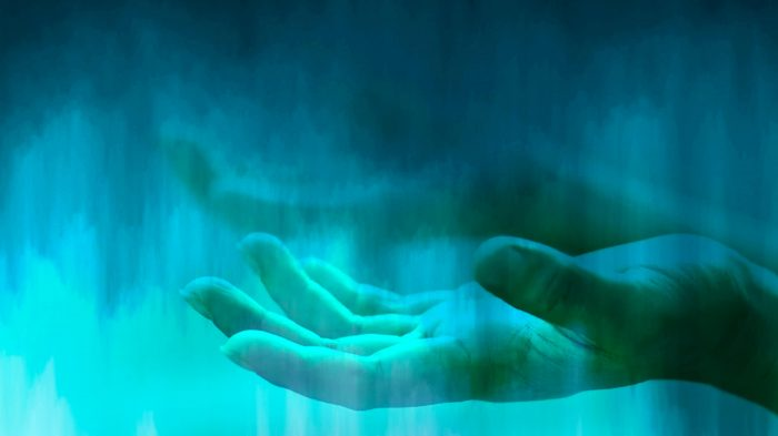aqua background (rain, clouds, under-water?) with open hands