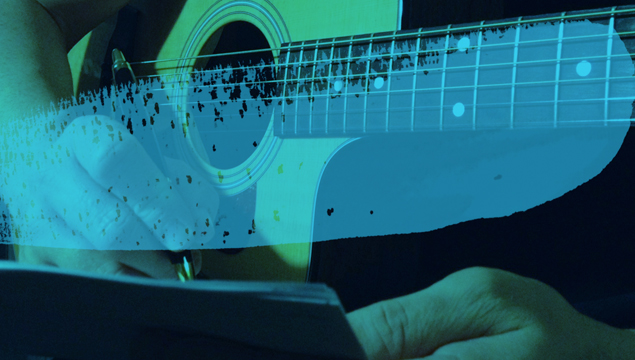 picture of person holding guitar and writing music