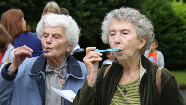 photo of two older ladies blowing bubbles
