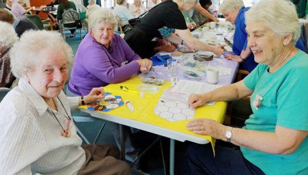 photo of respite group doing craft activities