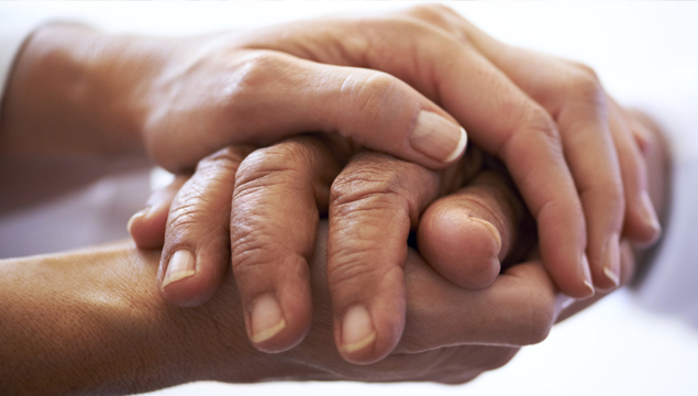 photo of hands clasped around another pair of hands